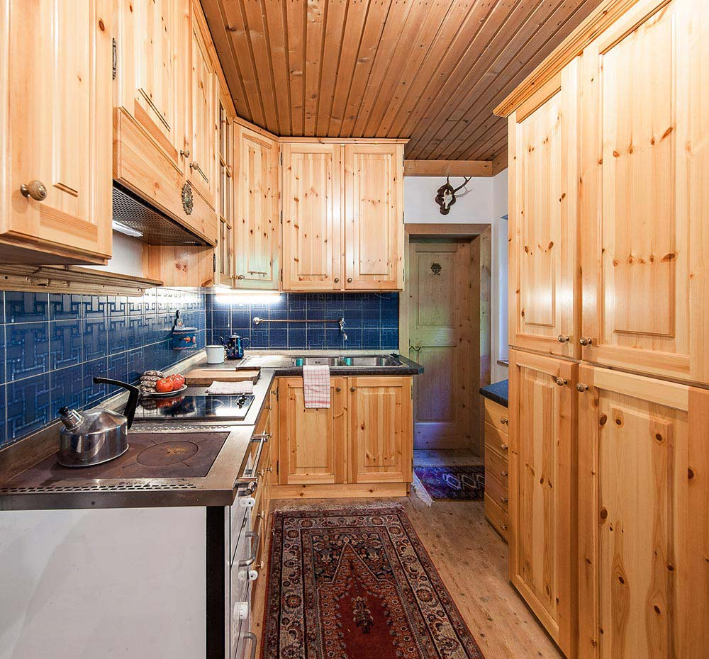 Kitchen with wood-stove and electric hob